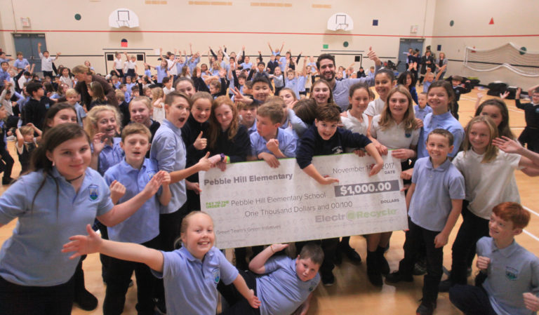 Pebble Hill Elementary receiving a giant cheque of $1000.