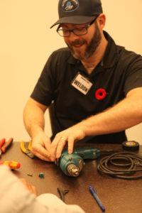 Volunteer fixing power drill