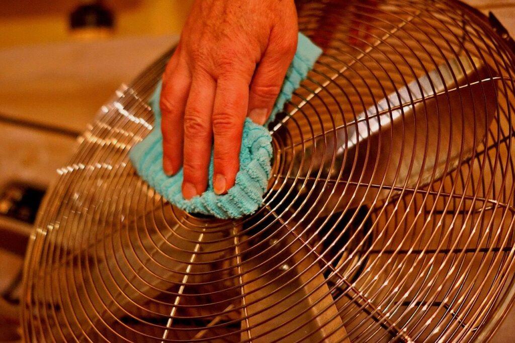 Fan being cleaned